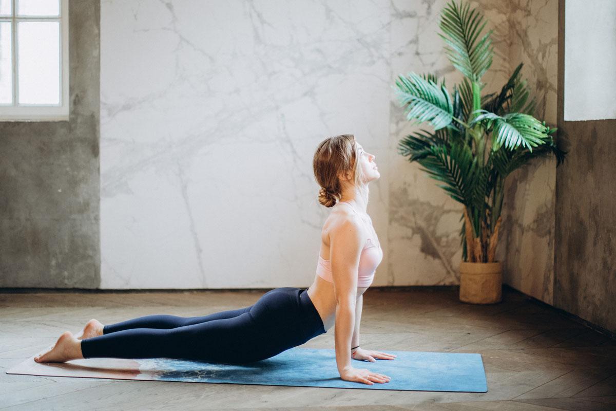 woman-in-pink-sports-bra-and-black-leggings-doing-yoga